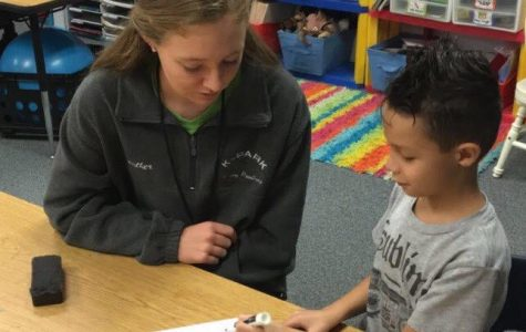 Women's basketball joins group of athletes who read books to elementary school students