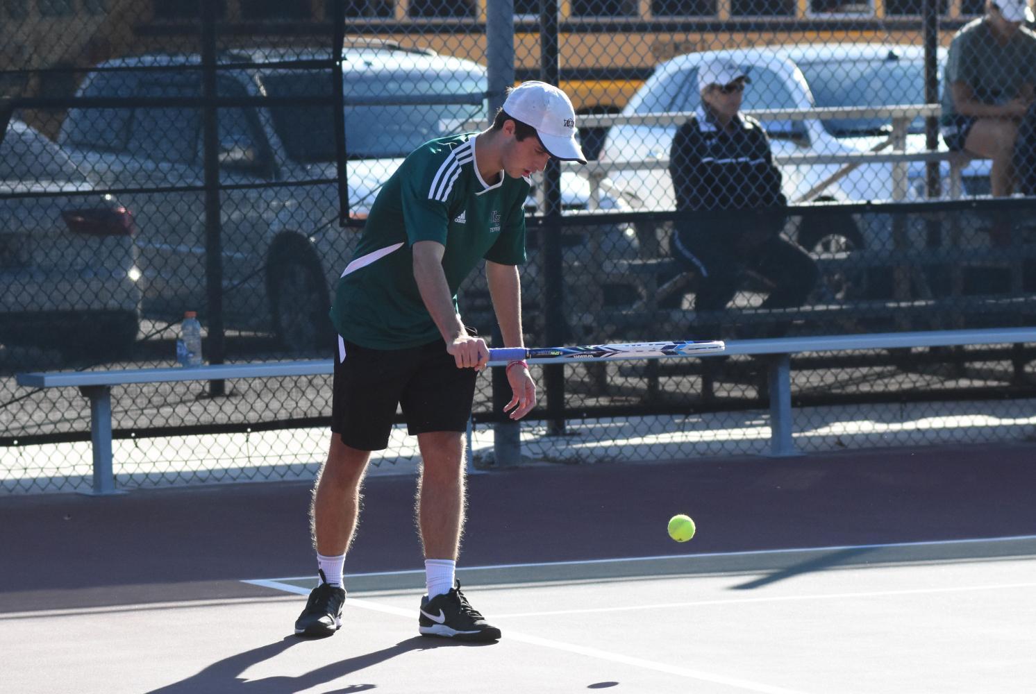 Guynes bounces a tennis ball before a serve during a tournament at K-Park.