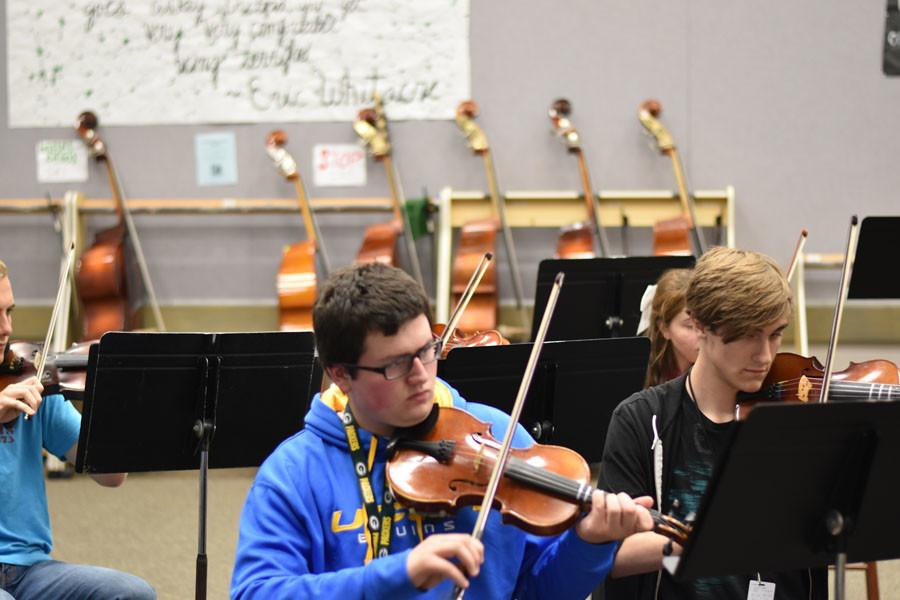 Students practice during class to prepare for the concert coming up.