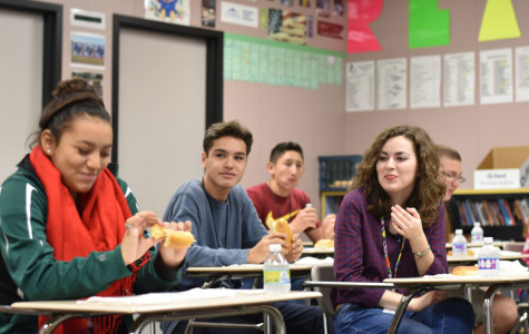 Brandon Ayala, Kindell Arcizo, and Emily Ausburn enjoy breakfast in den after winning the alternative high drawing contest.
