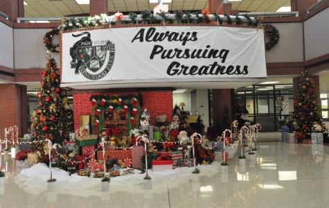 The sign always perusing greatness hangs over the Christmas decorations that were set up by our own KPARK kids.