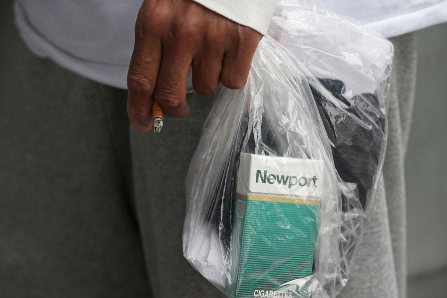 James Knight, 47, holds a plastic bag of items while smoking a cigarette outside the St. Louis Gateway Transportation Center on February 20, 2015, in St. Louis. Knight was released from Vienna Correctional Center earlier in the morning. (John J. Kim/Chicago Tribune/TNS)