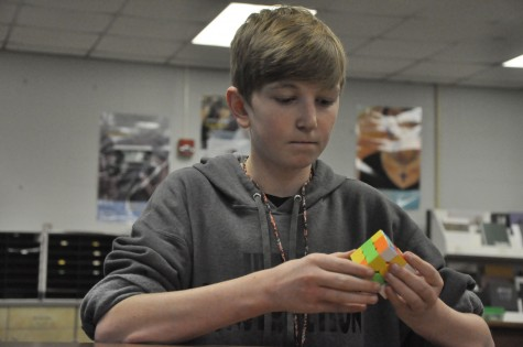 "Tim Reed contemplates his favorite puzzle. ""I think [the Rubik"