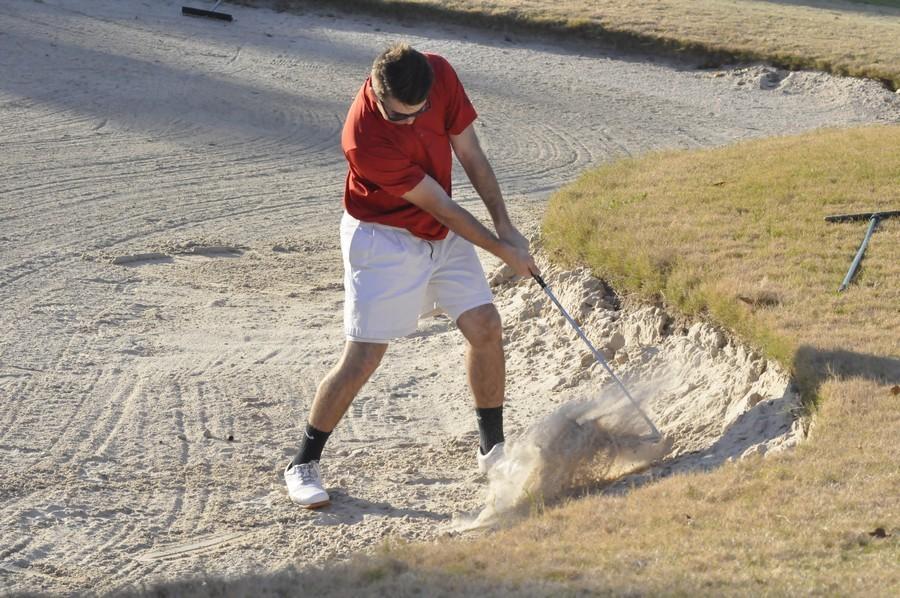 John Carl Budreaux hits a bunker shot on hole eight at oakhurst.