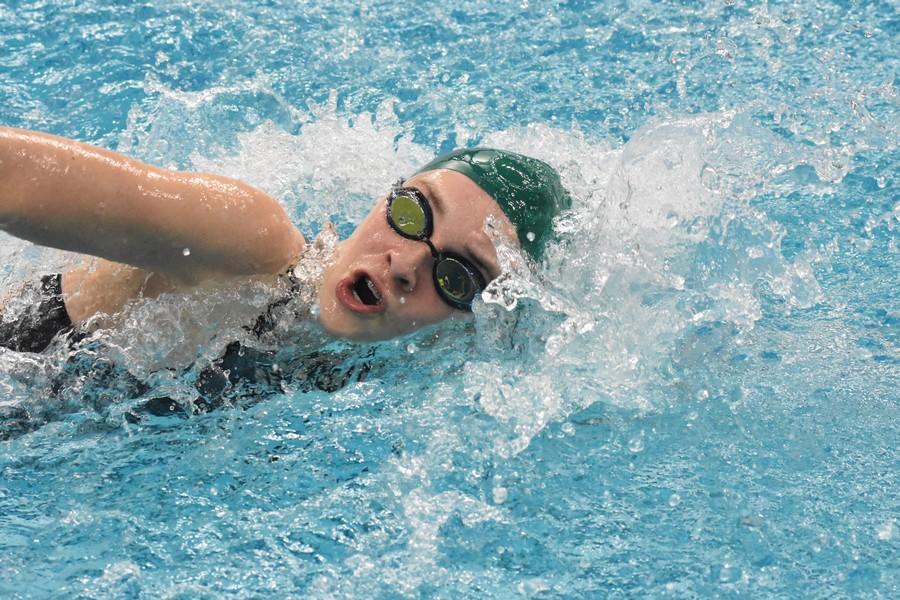 Freshman Andie Unwin swims one of her eight races at the state swim meet.