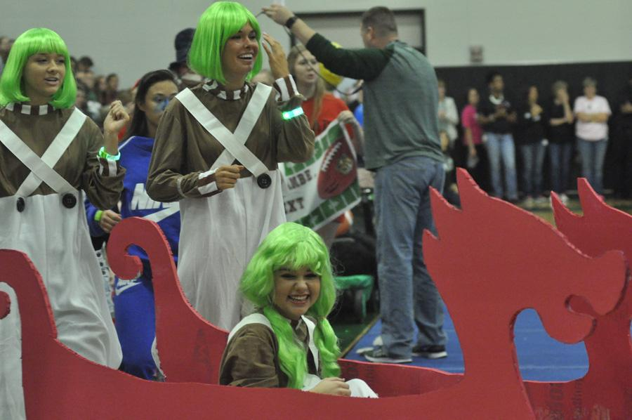 Juniors Audrey Manning, Katy Majerus, and Kassidy Luck dressed as Oompa Loompas in the Red Wagon competition on October 28.
