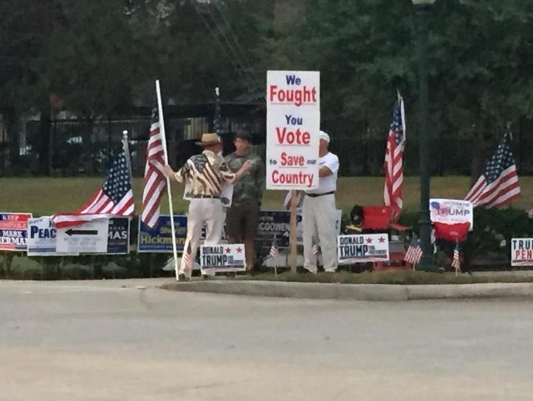 Citizens+hold+pro-Trump+signs+on+the+side+of+the+road+in+Kingwood.+Photo+contributed+by+Kolbey+Schoener.+