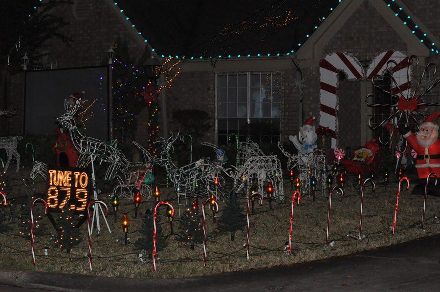 A+house+in+Greentree+Village+is+one+of+many+Kingwood+homes+decorated+for+Christmas.+Lights%2C+reindeer%2C+a+video+of+Santa+and+holiday+music+add+to+the+seasonal+flavor.