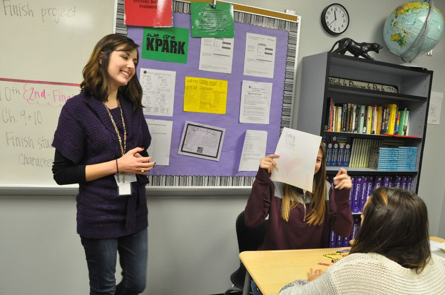 English teacher Abby Ausburn talks to her students.