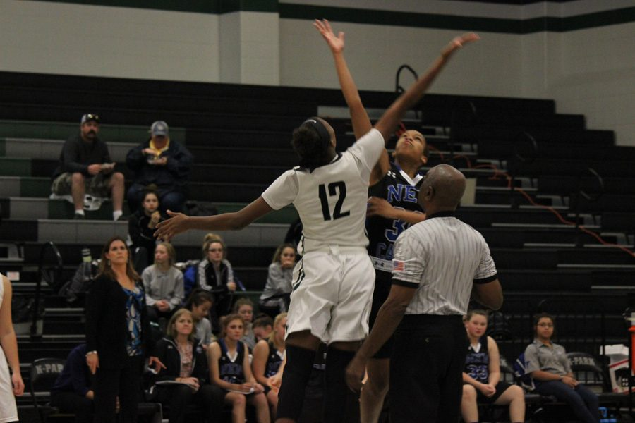 Sophomore Allie Byrd reaches to win the tip off against New Caney at their game on December 2.