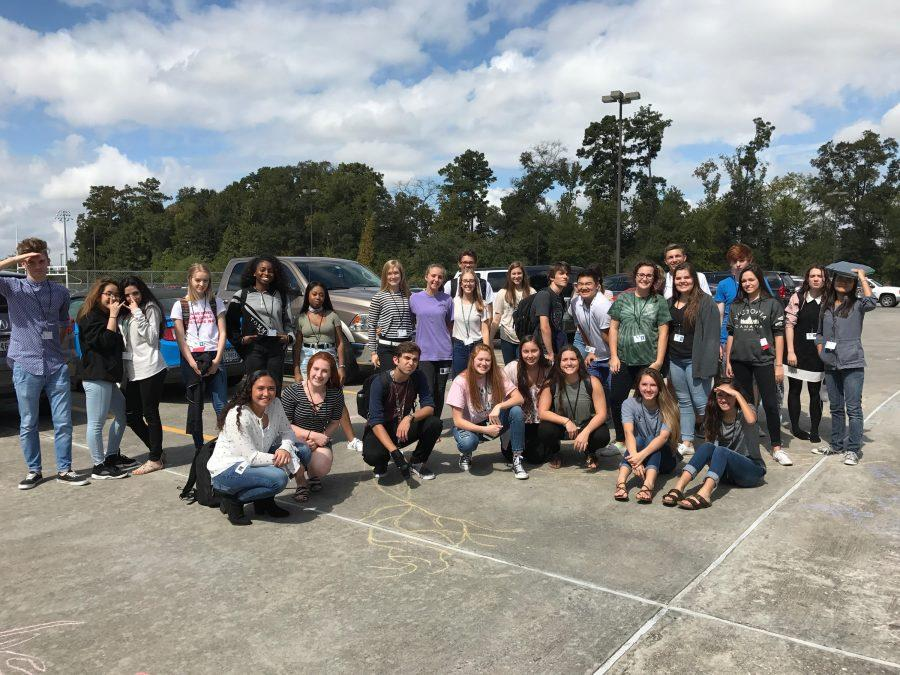 Amy Balke's 5th period AP psychology class in the school parking lot after drawing the structure of a neuron with sidewalk chalk.
