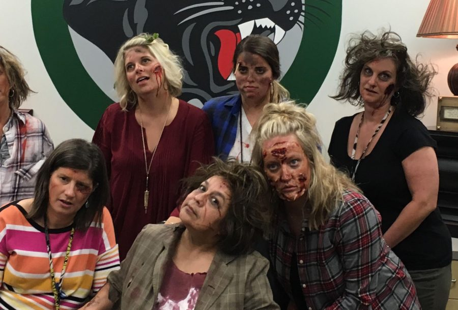 Teacher of the year Amy Balke, back row center, and several other teachers in zombie makeup as part of an interactive activity in Balke's AP psychology class.