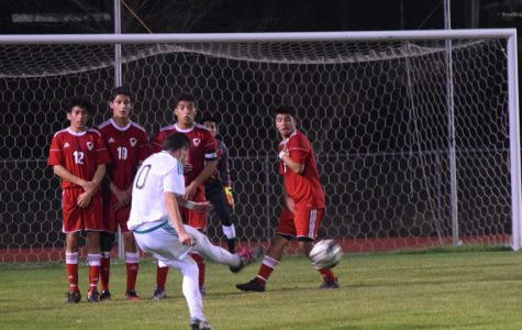 Boys soccer players, satisfied at last, are going to playoffs
