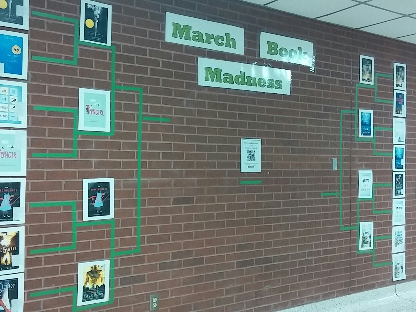 The KPHS library's March Book Madness wall in the second round. Photo courtesy Jessica Castille.