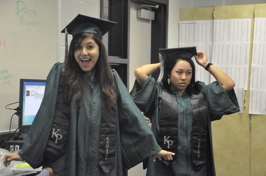 2016 K-Park graduates Stefanie Mendez and Tori Gatling try on their caps and gowns.