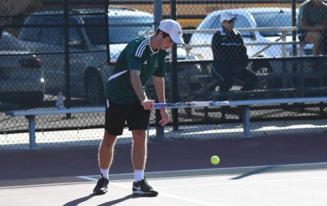 Guynes bounces a tennis ball before a serve during a tournament at K-Park.