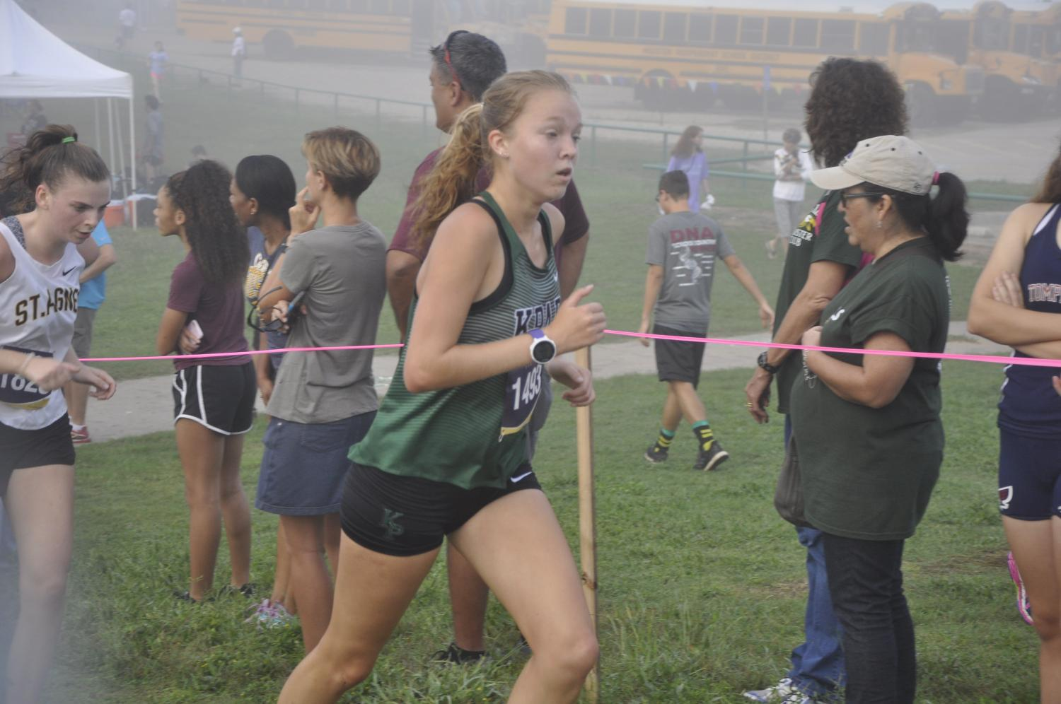 Senior Kimber Watson, a varsity XC runner, competes at the Brenham Hillacious meet.
