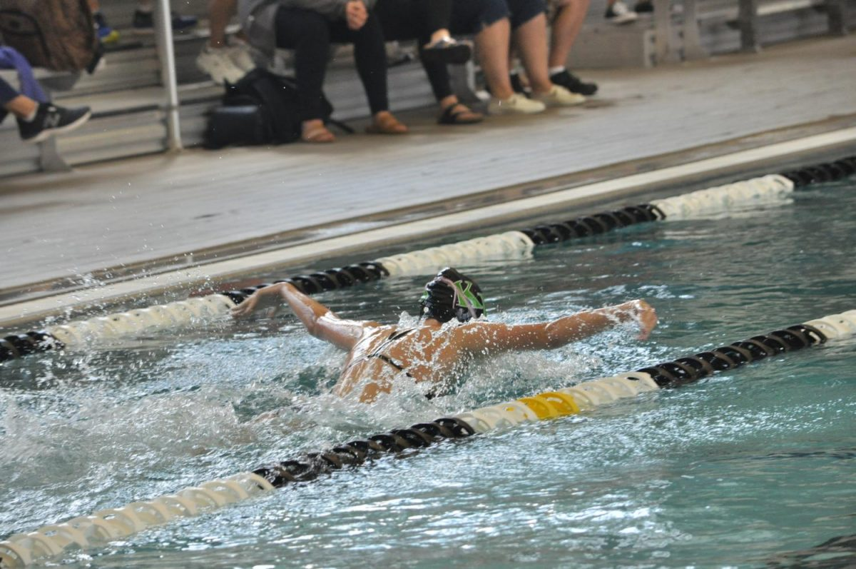 Senior Danielle Rose races in a Fly event at the Sept. 29 swim meet.