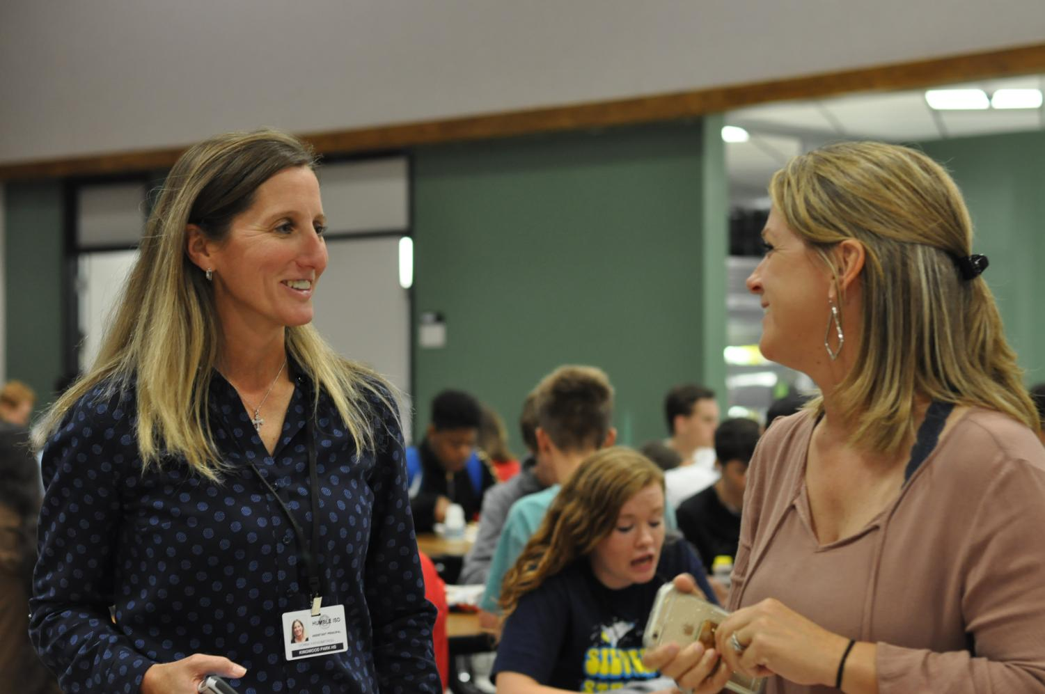 Dr. Donna Papadimitriou and Dr. Amy Wallace visit during cafeteria duty in August. The two just started working together when Dr. Papadimitriou became an assistant principal in July, however, they have known each other many years. Both are assistant principals at KPARK now.