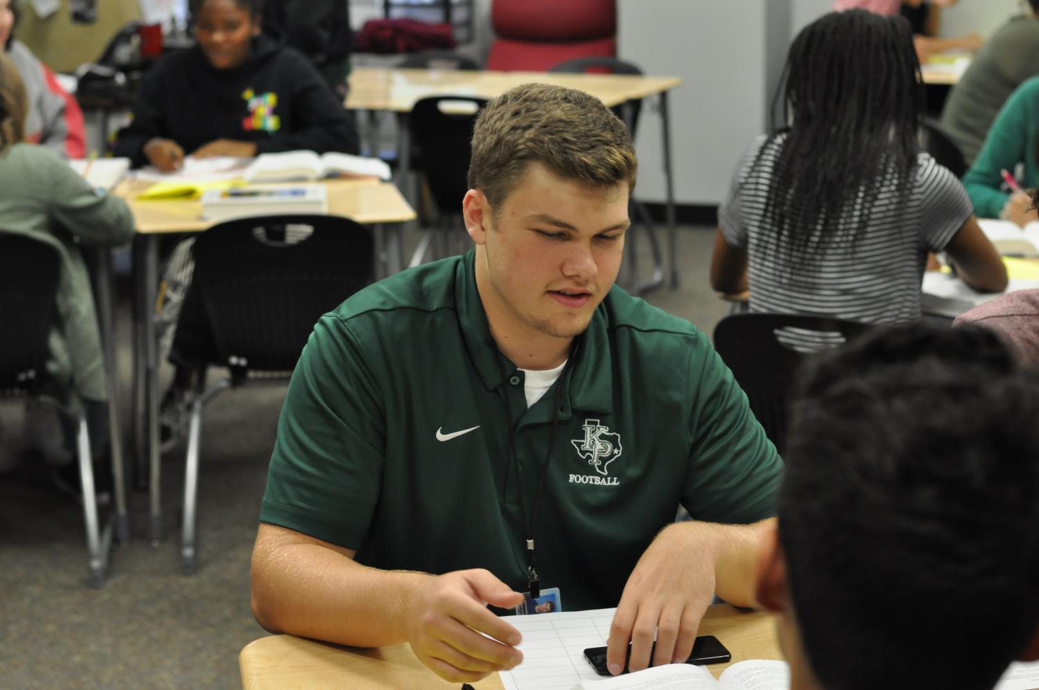 Junior Ronan Keeler works on a group project in English III. After transferring from St. Martha, Keeler has found his groove in the classroom and on the field.