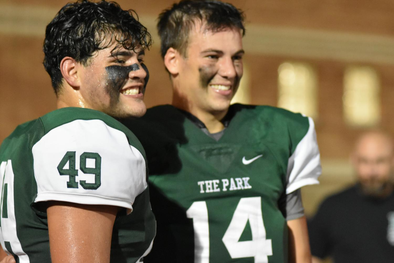 Seniors Hayden Park and Sam Johansen celebrate together after defeating Porter on Sept. 29. They have helped lead the team to a 3-0 district record. They will face New Caney this weekend, a team that is also 3-0 in district play.