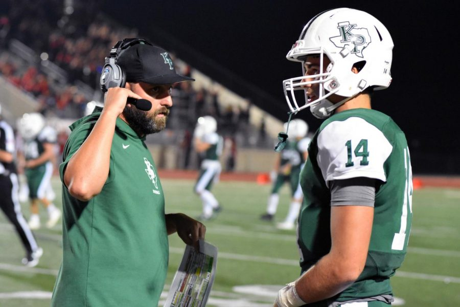 While+the+defense+is+on+the+field%2C+offensive+coordinator+Bruce+Cox+uses+his+headset+to+talk+with+the+coaches+watching+from+the+Press+Box+as+he+gives+tips+to+senior+quarterback+Sam+Johansen.+