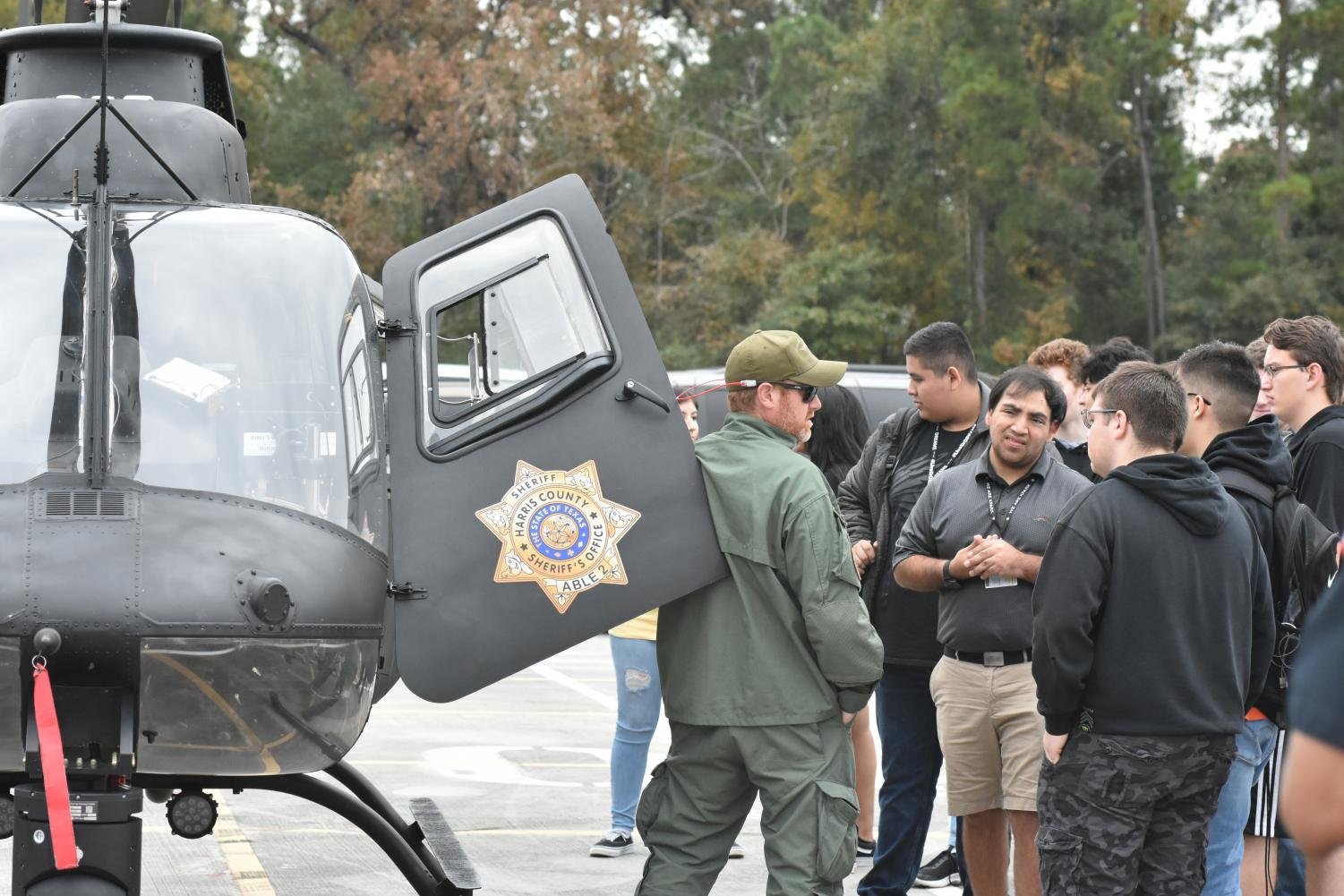 Students in teacher Scarlett May's Criminal Justice class meet professionals after a police helicopter arrived on campus for a special event for the class.