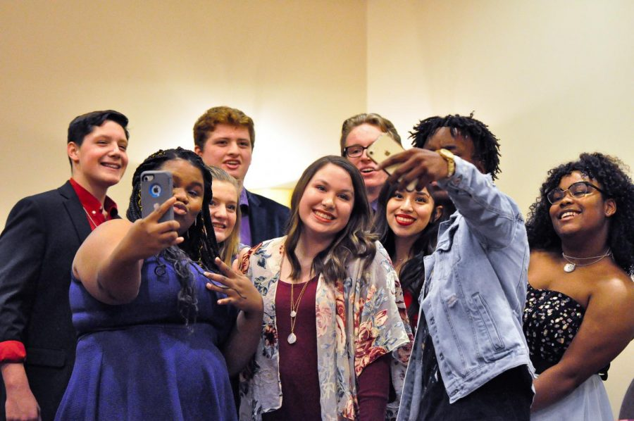 Humble Voice contestants take a group selfie before going on stage.