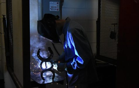 Sparks fly as senior Moises Smith welds in class during 6th and 7th period on weekdays.