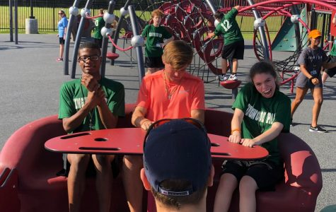 Sophomore Freddie Lillie and freshman Ella Cockrell join some other students on an activity at the playground that is part of the new Insperity Adaptive Sports Complex. There are also two baseball fields and a covered court. Photo contributed by Shana Guy