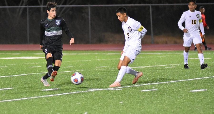 Junior Robert Henry looks up the field as a defender closes in on him. The boys have had a lot of success during the first part of the season.