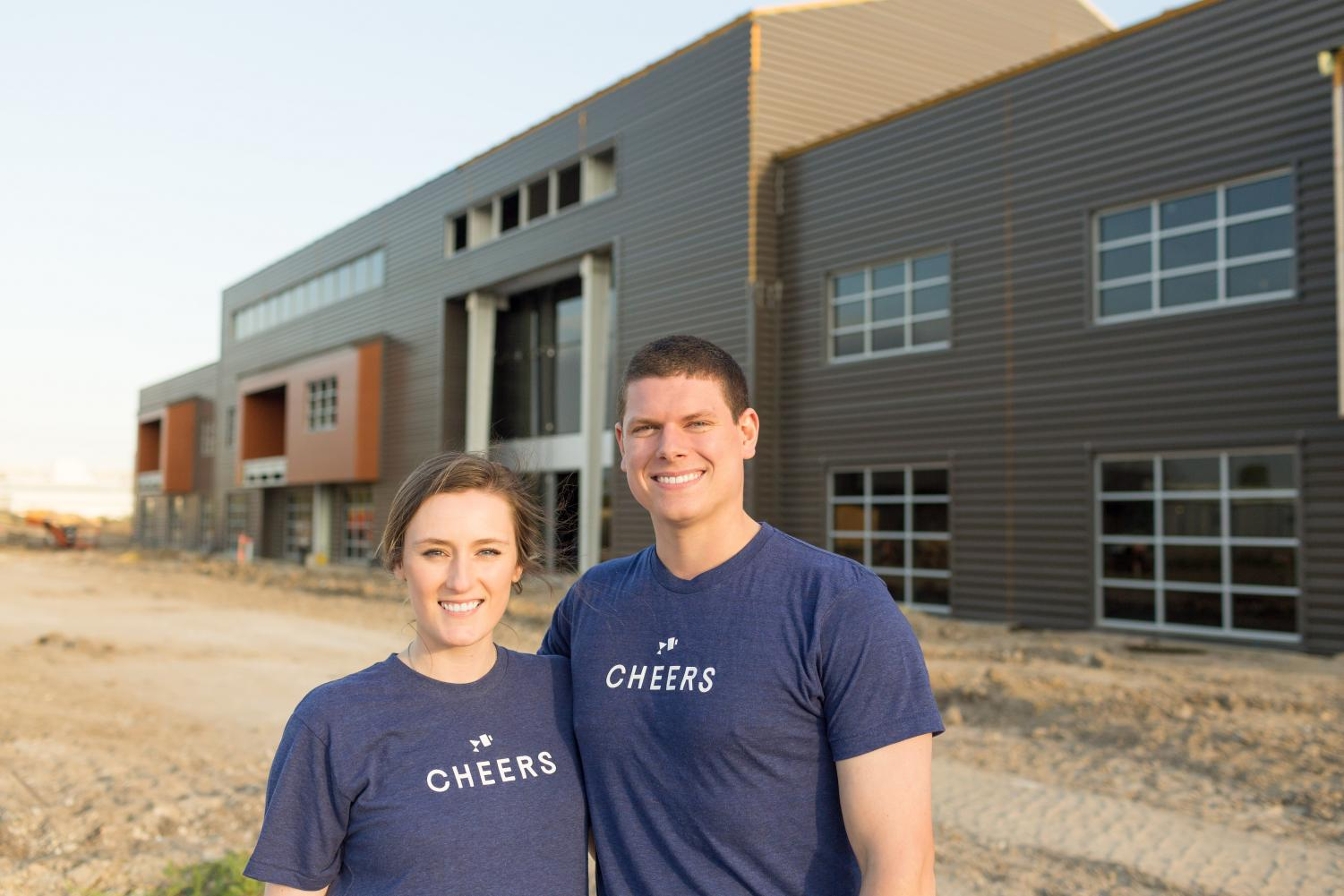 Brooks and Shelby Powell, who both graduated from Kingwood Park in 2012, stand outside of their new office building that is almost done being built.