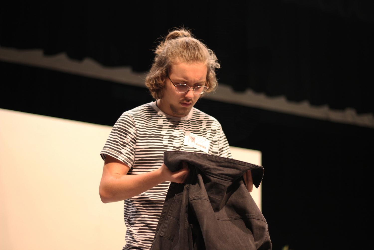 """Junior Evan Janacek, who plays the lead role of """"Seymour"""" in the musical """"Little Shop of Horrors,"""" practices a scene during after school rehearsal. The cast has rehearsals nearly everyday leading up to the opening night on Nov. 14."""