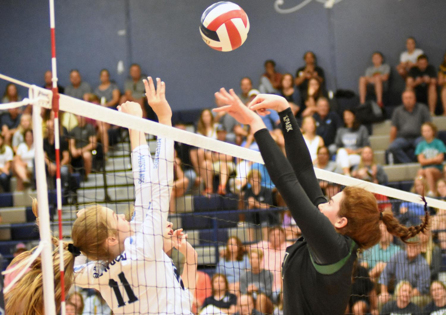 Senior LIbby Overmyer blocks the ball against Kingwood High School in a match earlier this season. Overmyer was the MVP of the state tournament last year as she helped lift the Panthers to the 5A state title.