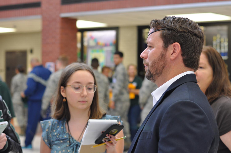 Opinion editor Blanca Cantu, senior, interviews congressman Dan Crenshaw during a visit to Kingwood Park in September.