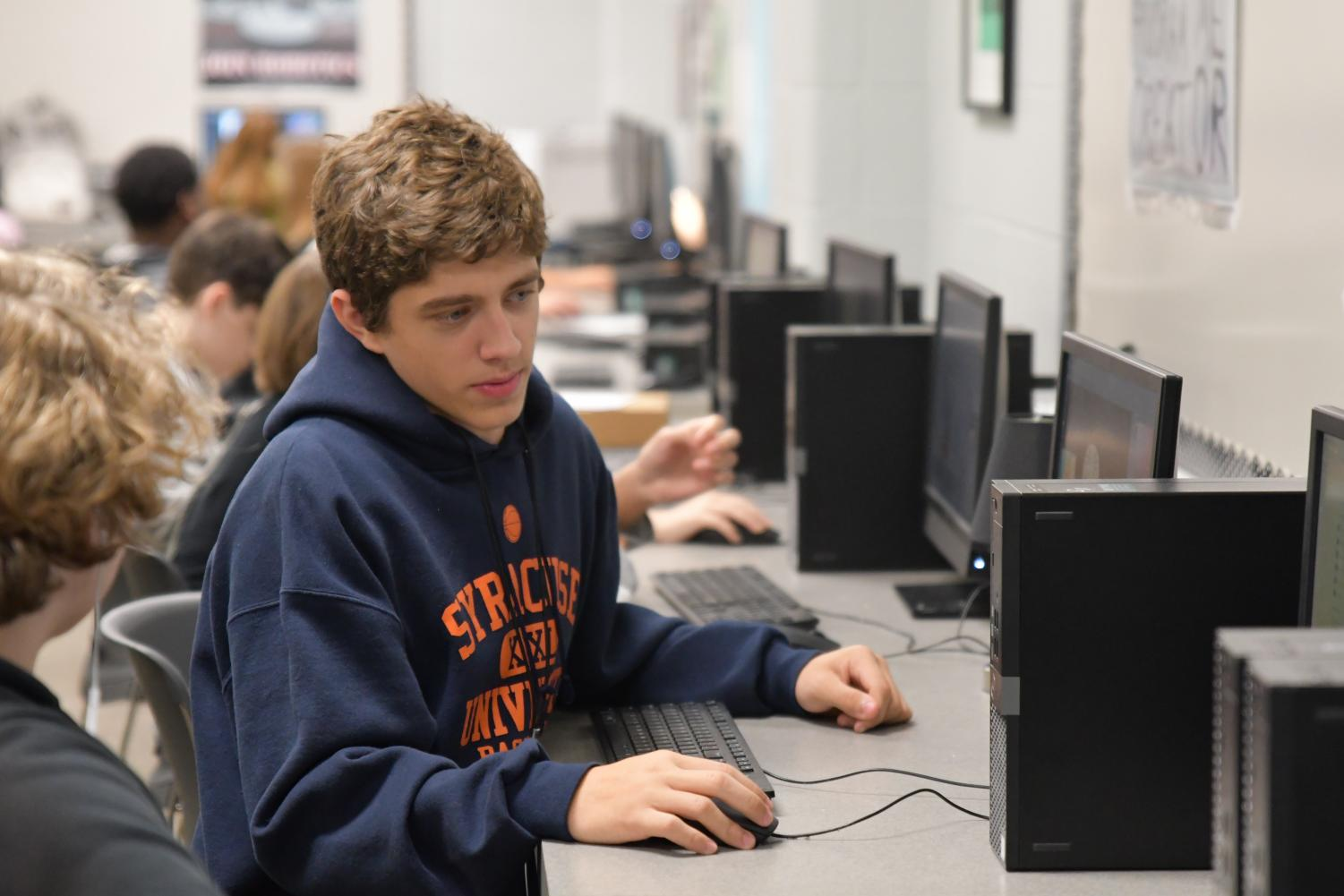 Senior Brett Fahrenholz focuses on a graphic design project in Tonya Smith's class in October. Fahrenholz quit football to be able to focus more on wrestling.