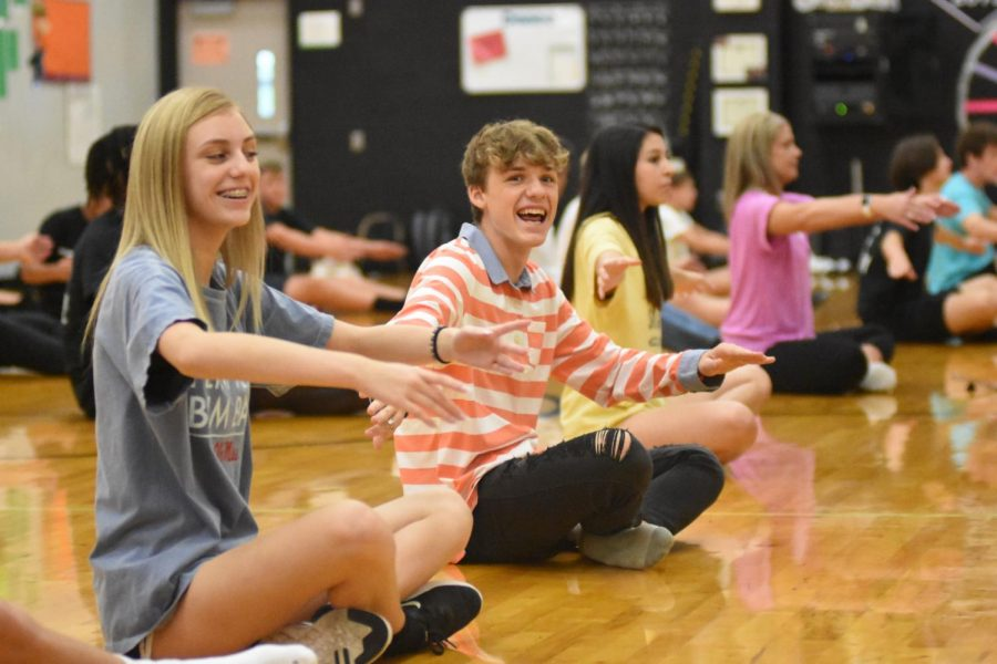 Silver Star sophomore Britelyn Zeleskey and sophomore Tristen Glazebrook practice arm positions in dance class.