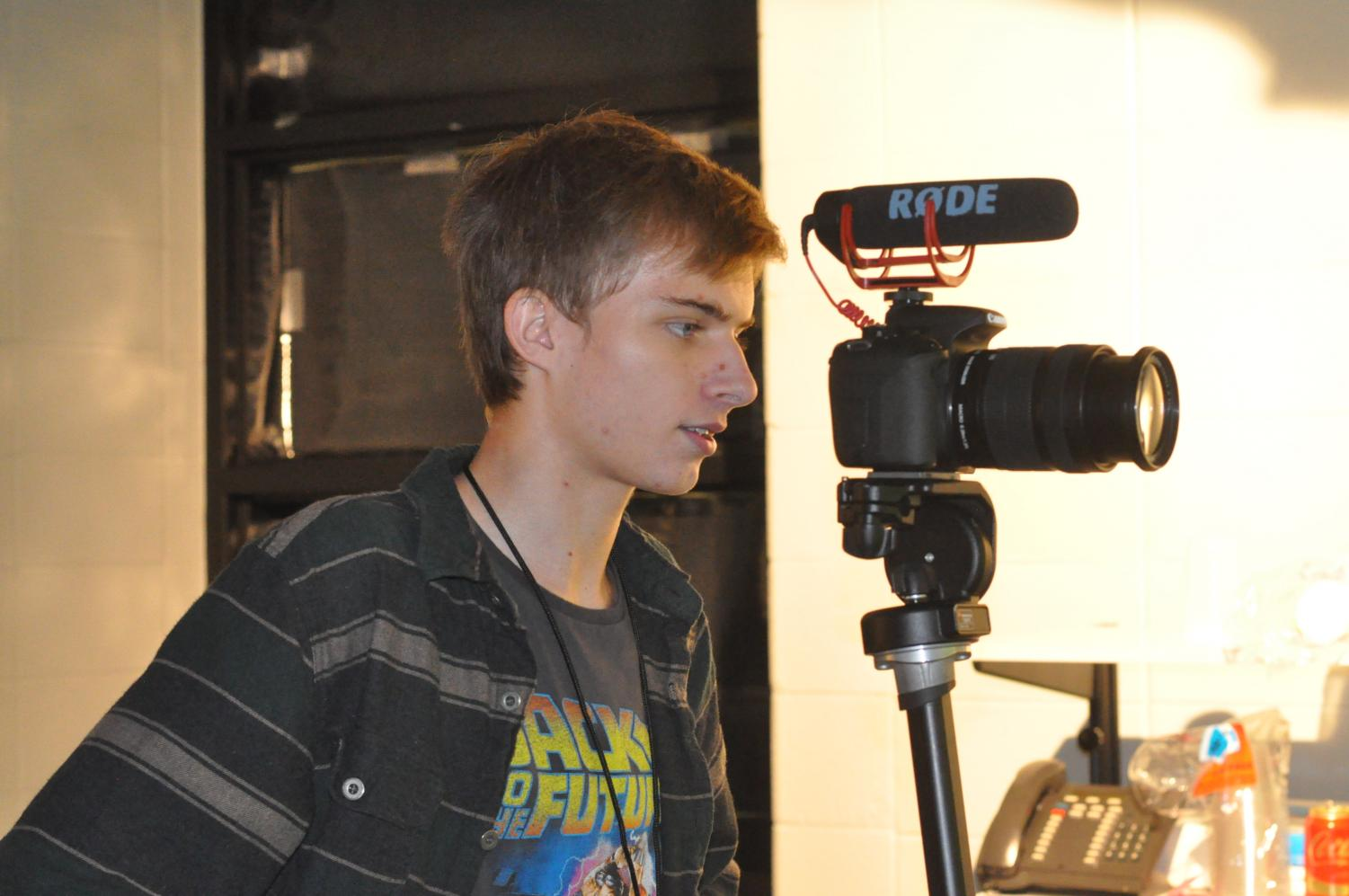Elijah Monks, a senior who has been involved with Audio-Visual Production since he was a sophomore, checks to make sure the video he is filming has good lighting. The students used to create monthly program called KPARK News.