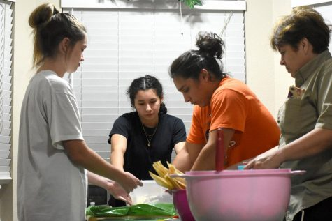 "Juniors Crosslin Silcott, Anaih Ibarra and Richard Rivera help prepare the masa for a new batch of tamales on Sept. 21 while Richard's mom Jaqueline Rivera assists. ""It was 15 of us in the kitchen,"" Richard said of the weekend the journalism students made 900 tamales at his house. ""We don't really see each other that much because we're in different classrooms, but I felt like I got to know them a lot more because we're all talking to each other while we were doing it and just talking about everything and listening to our music."""