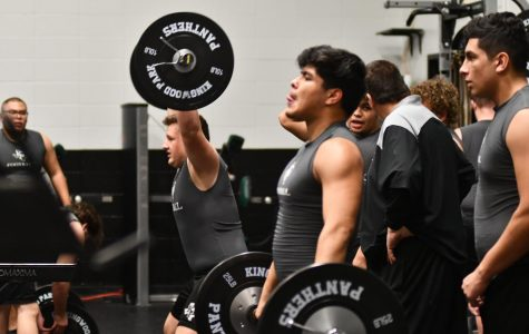 Freshman Cameron Maxey and junior Juan Garcia work out during class.   Each sport rotated through the weight room on certain days so all teams could take advantage of it.