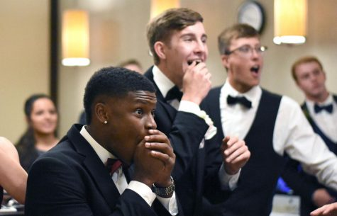 Taking a break from prom, 2019 seniors gather around to watch the NBA playoffs last May.