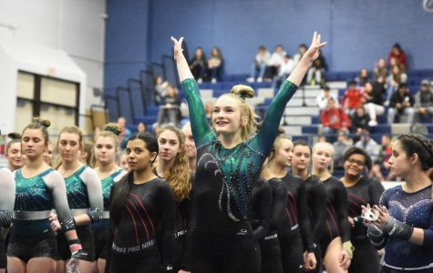 Freshman Josie Winters is introduced to the crowd as Kingwood Park's name is announced at the Kingwood Invitational earlier this year.