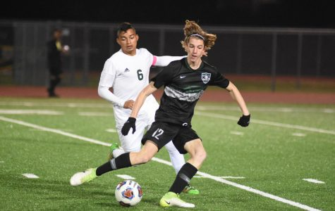 Senior Jacob Bruce dribbles away from a Sharpstown player earlier this year. The Panthers were eliminated by Sharpstown one game away from State last year but avenged that loss this season. The boys were undefeated and dominated the district prior to the season being suspended.