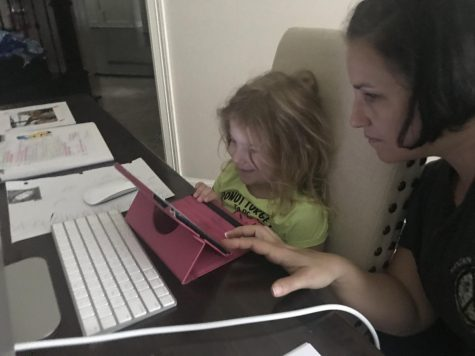 Earlier this month, algebra teacher Kathryn Espinosa sits with her 6-year-old daughter Lilly as she works on her kindergarten homework.