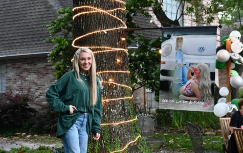 Seniors, like Kyra Ivy, lit up their yards in celebration on May 1. They are finishing their last nine weeks of school from home since distance learning was implemented to keep the community safe.