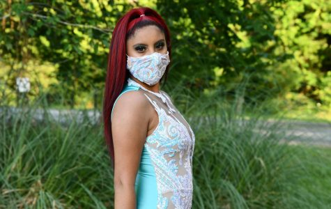 Senior Crystal Vargas poses at Deer Ridge park in her prom dress and a matching face mask.