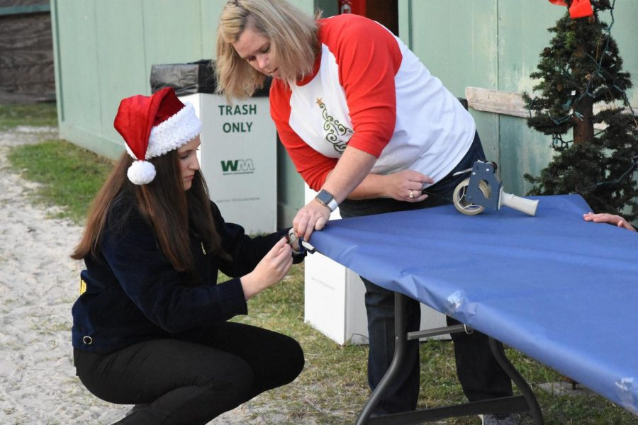 During the week of Santa's Farm at the FFA barns, FFA teacher Genevieve Ubnoskye works with students to get the barns decorated and ready for the community to tour.