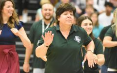 Chemistry teacher Laurie Rosato participates in the teacher dance during the first day of school pep rally.