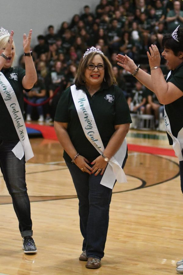 Counselor Gina Sanchez is cheered on by colleagues Pamela Workman and Laurie Rosato. Sanchez was crowned on the faculty court during homecoming week.