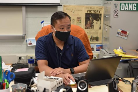 "Calculus and precalculus teacher Jim Dang works in his classroom on Aug. 12. The school year started on Aug. 11 and will be virtual until Aug. 24. ""We as a school are very resilient, strong minded,"" Dang said. ""As a family and school we'll find a way to get through this."""